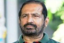 What awaits Kalmadi as he returns to India?