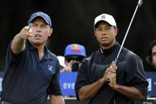 Woods opens Australian Masters defence with a 69