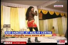 Bar dancers perform at a state health function