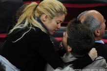 Shakira kisses boyfriend Gerard Pique in public