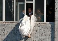 Caught on cam: Bride attempts suicide