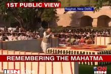 In Pics: PM, Sonia visit Rajghat on Gandhi Jayanti