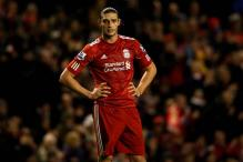 Carroll plans Liverpool stay amid exit rumours
