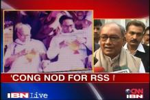 RSS, Digvijaya clash over photo row