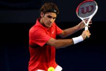 Federer crushes Tomic to enter Aus Open quarters