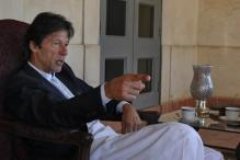 Imran Khan calls for early polls, won't back coup