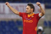 Juventus win 2-0 at Atalanta; Totti sets record