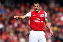 Van Persie escapes action over elbow in FA Cup win