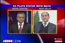 EC defends decison to cover Mayawati's statues