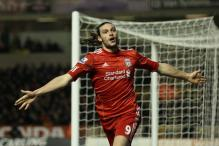 Carroll scores as Liverpool beat Wolves 3-0
