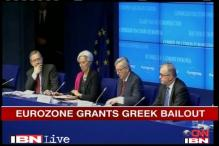 After bailout, Greek govt agrees to cut wages, jobs