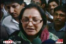 UP: Jaya Prada slips while climbing the dais