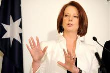 Oz PM calls party vote as challenger rises