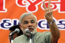 A few elements trying to disturb Guj peace: Modi