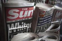 Murdoch to fight back, launching 'Sun on Sunday'