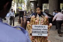 Snapshot: PETA's coat festooned with baby limbs