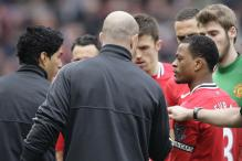 Suarez apologizes for snubbing Evra handshake