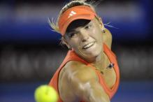 Wozniacki ousted in Qatar Open, Azarenka wins