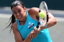 Bartoli holds on to progress at Charleston