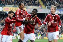 Milan turn focus to league as Juventus chase