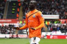 Cisse brace takes Newcastle past Swansea 2-0