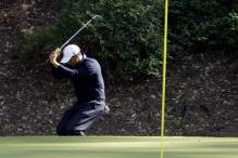 Woods brought to task for kicking his golf club