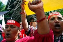 May Day: Asia's workers demand pay hikes