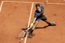 Federer gets record Grand Slam match win