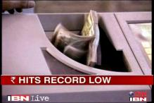 Rupee continues to slide, hits record low