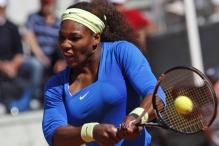 Serena in Italy semis after Pennetta retires