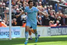 Aguero pledges future to City despite Madrid link