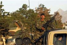 Afghan Taliban attack hotel, police free 18