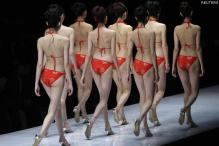 China: Bikini-clad TV presenters told to cover up