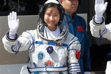 China sends first woman into space