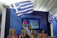Greek rivals near coalition, seek bailout revision