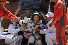 Chinese astronauts parachute land after mission