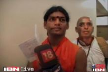 Nithyananda's surrender evokes mixed response