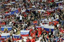 UEFA charges Russia over fan violence