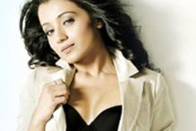Actress Trisha is Jayam's booster in 'Boologam'