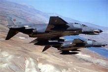 Turkey blames Syria for jet attack, consults NATO