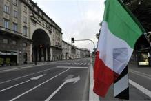 Moody's downgrades Italy, warns of further cut