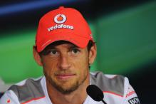 Button surprised by Alonso 'arse-kissing'