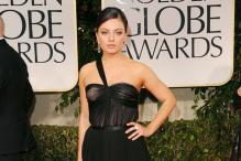 Mila Kunis would like to play a girl-next-door