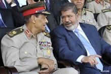 Egypt president sacks defence minister, army chief