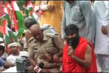 Ramdev detained, to be taken to Bawana