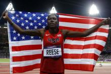 Olympics: American Reese wins long jump gold