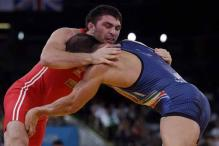 Sharifov wins men's wrestling 84kg gold