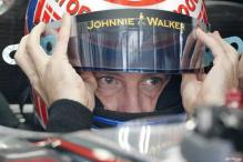 Button takes pole position for Belgian GP
