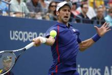 Djokovic eases through, Roddick delays retirement