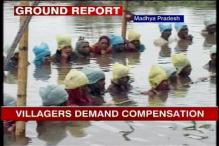 In neck-deep water for days, villagers demand land